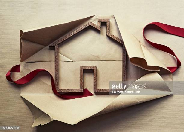 House shape in unwrapped gift