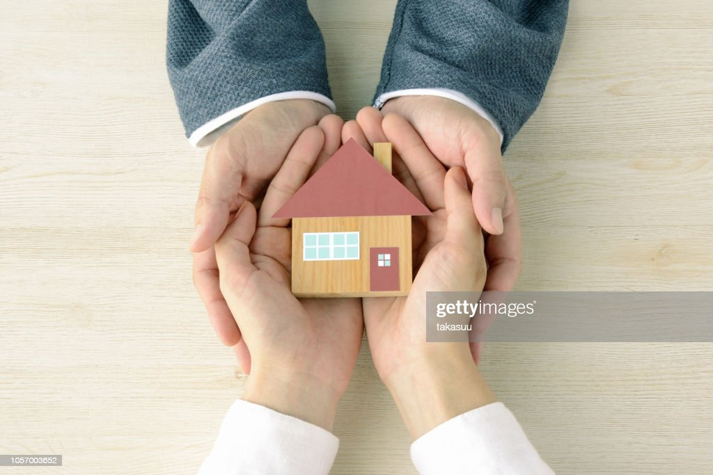 House shape object covered by hands : Stock Photo