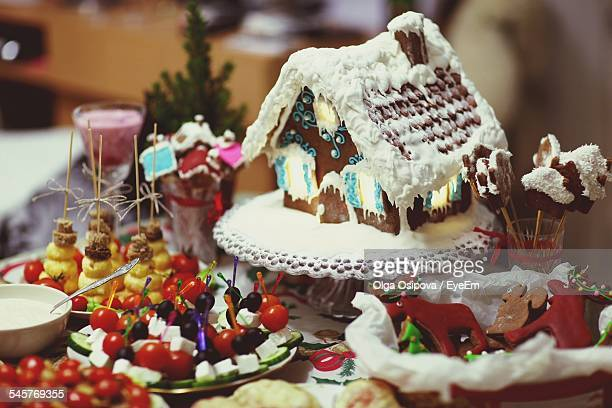 House Shaped Cake And Fruits On Table During Christmas