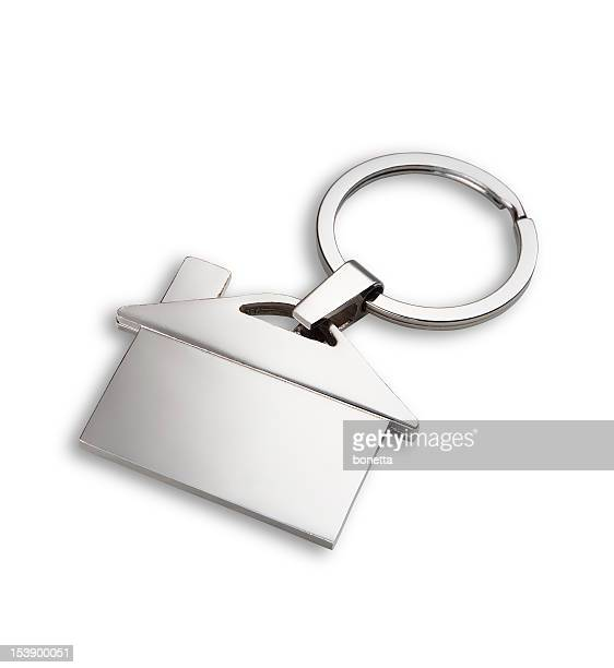 house shaped key chain on white background