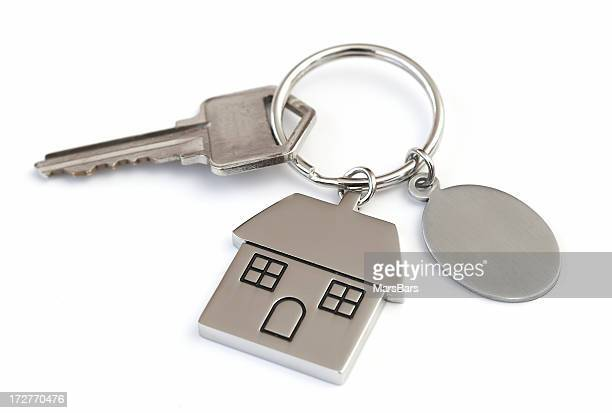 house shaped keychain with blank tag - house key stock photos and pictures