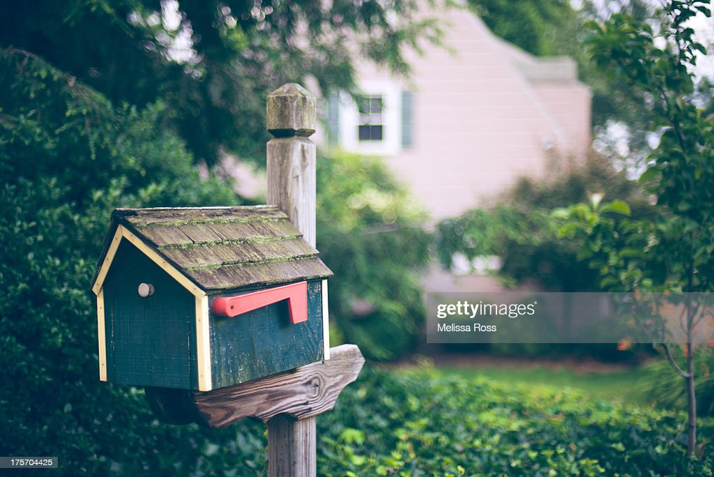 House shaped mailbox or postbox : Stock Photo