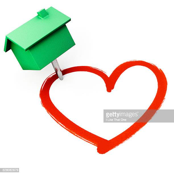 house shaped pin stuck into a heart shape - atomic imagery stock pictures, royalty-free photos & images