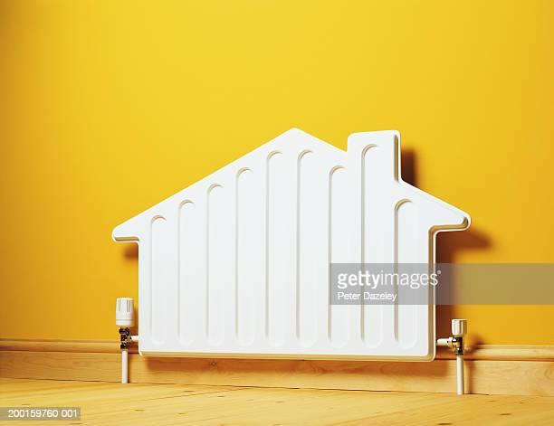 house shaped radiator on wall - 暖房用ラジエーター ストックフォトと画像