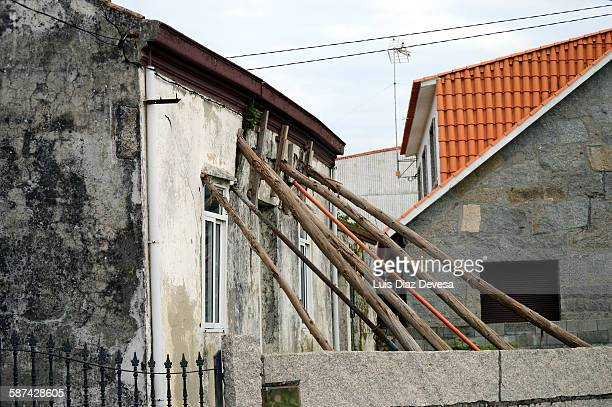 house shored - cave in collapsing stock photos and pictures
