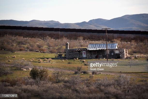 A house sits along the border wall that separates the United States and Mexico on January 26 2019 near Jacumba California The US government had been...