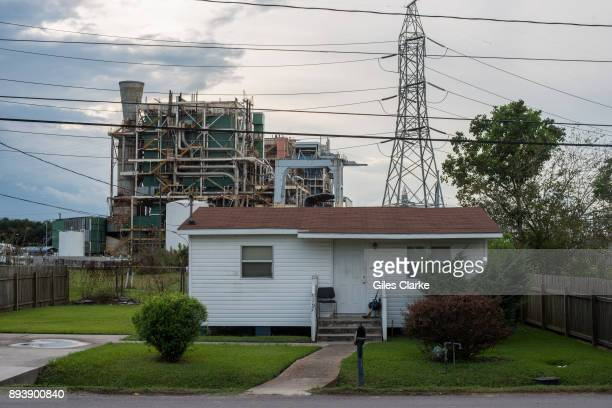 House sits along the long stretch of River Road by the Mississippi River and the many chemical plants October 12, 2013. 'Cancer Alley' is one of the...