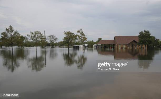 A house sits on flooded waters on highway 124 on September 20 2019 in Beaumont Texas Gov Greg Abbott has declared much of Southeast Texas disaster...