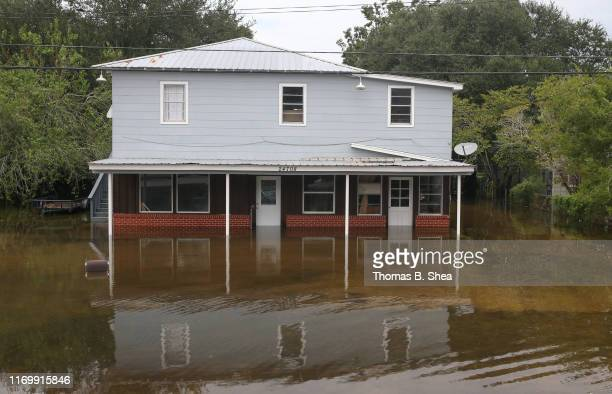 A house sits on the flooded waters on highway 124 on September 20 2019 in Beaumont Texas Gov Greg Abbott has declared much of Southeast Texas...