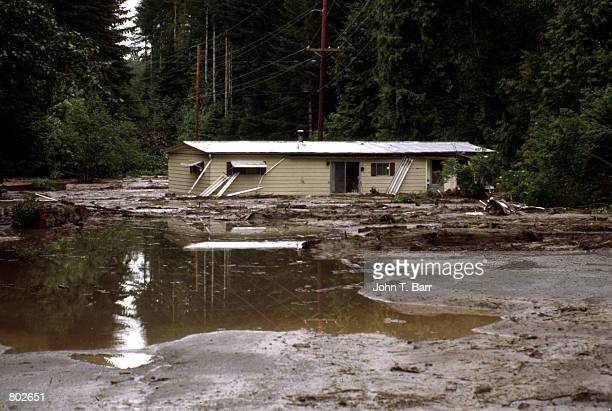 A house sits submerged in water May 23 1980 in the aftermath of the Mount St Helens eruption in Mount Saint Helens National Volcanic Monument WA...