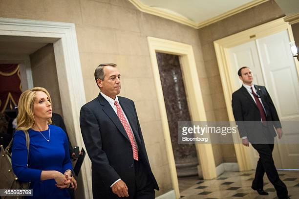House Speaker John Boehner a Republican from Ohio center makes his way to his office at the US Capitol ahead of a budget deal vote in Washington DC...