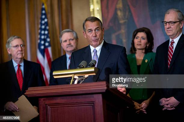 House Speaker John Boehner, a Republican from Ohio, center, speaks during an enrollment ceremony before signing the Keystone XL Pipeline Approval Act...