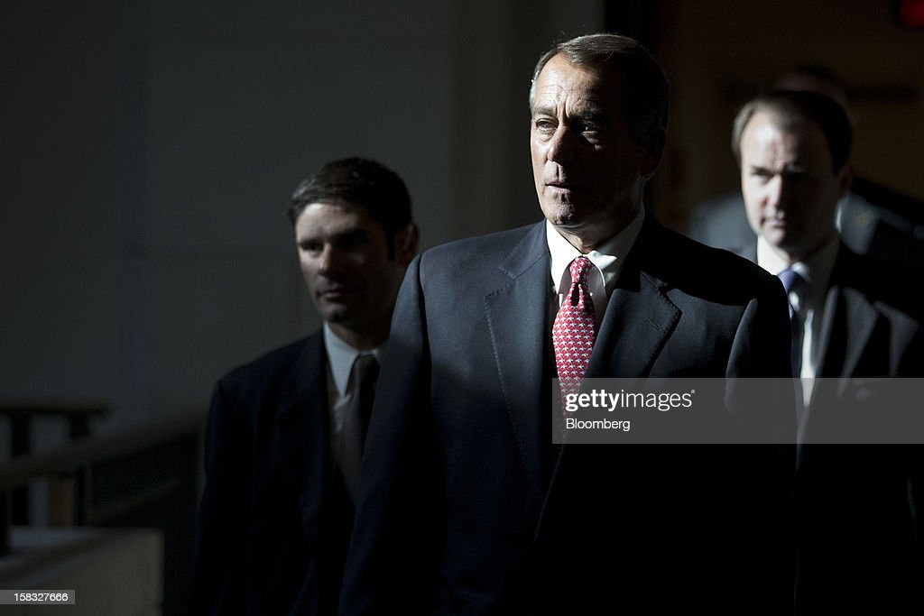 House Speaker John Boehner, a Republican from Ohio, center, walks to a news conference in Washington, D.C., U.S., on Thursday, Dec. 13, 2012. Boehner repeated his insistence that President Barack Obama's budget proposal is 'anything but' balanced and accused the president of being 'not serious' about cutting spending. Photographer: Andrew Harrer/Bloomberg via Getty Images