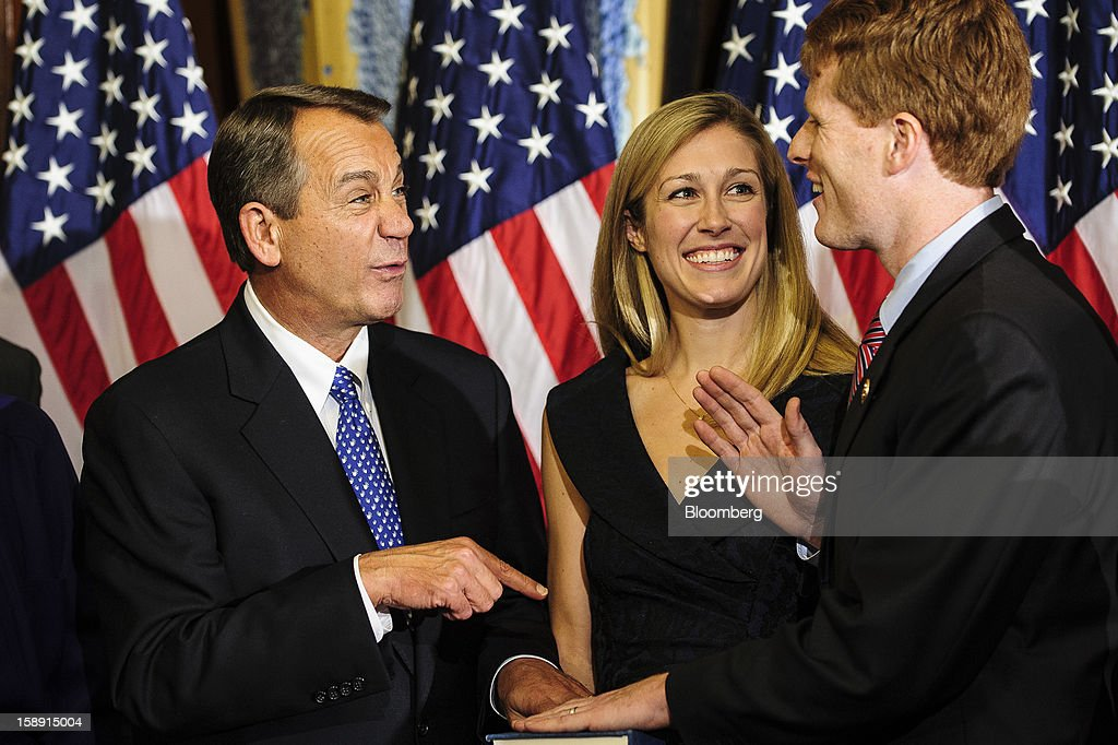 House Speaker John Boehner, a Republican from Ohio, left, jokes with Representative Joe Kennedy III, a Democrat from Massachusetts, right, as Kennedy's wife Lauren Birchfield, center, looks on during a mock swearing-in ceremony at the U.S. Capitol in Washington, D.C., U.S., on Thursday, Jan. 3, 2013. Kennedy is the grandson of Robert F. Kennedy, who served as U.S. attorney general and ran for President in 1968. The 113th Congress convenes today in Washington where new members will try to meld their diverse backgrounds in a legislature containing a record seven openly gay lawmakers, an unprecedented 20 women in the Senate and the first all-female state delegation, from New Hampshire. Photographer: Pete Marovich/Bloomberg via Getty Images