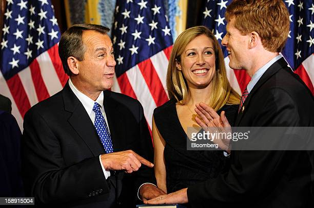 House Speaker John Boehner a Republican from Ohio left jokes with Representative Joe Kennedy III a Democrat from Massachusetts right as Kennedy's...