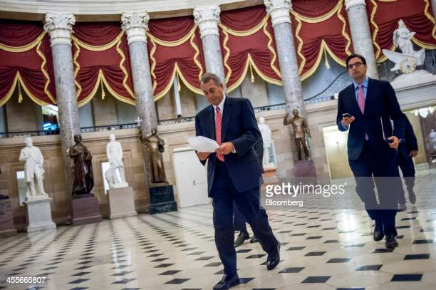 House Speaker John Boehner a Republican from Ohio left makes his way to the House chamber at the US Capitol ahead of a budget deal vote in Washington...