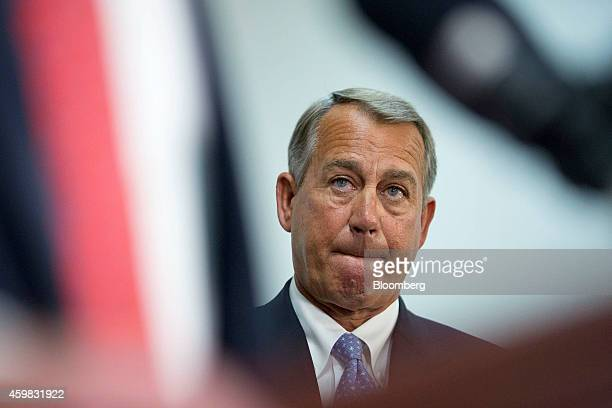 US House Speaker John Boehner a Republican from Ohio listens during a news conference after a House Republican Conference meeting at the US Capitol...