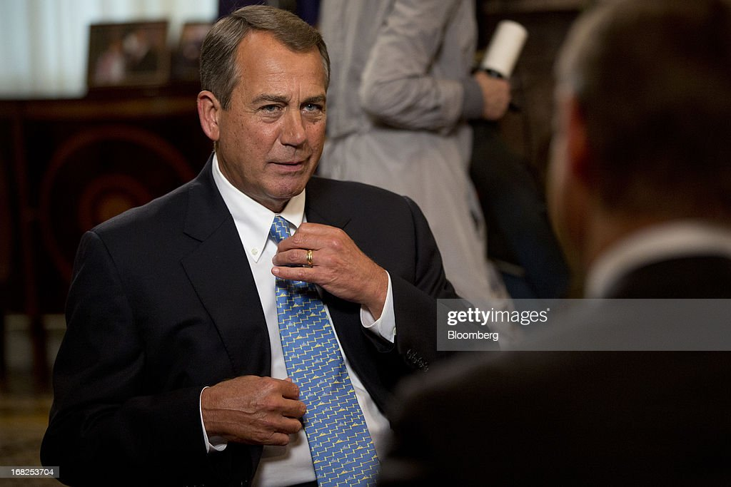 House Speaker John Boehner, a Republican from Ohio, talks to Bloomberg Television reporter Peter Cook, right, prior to an interview at the U.S. Capitol in Washington, D.C., U.S., on Tuesday, May 7, 2013. Boehner said he probably won't support legislation to let states require out-of-state Internet retailers to collect sales taxes, saying it would be too cumbersome to implement. Photographer: Andrew Harrer/Bloomberg via Getty Images