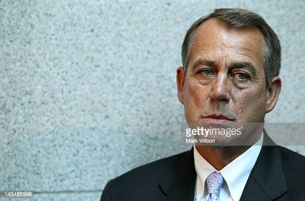 S House Speaker John Boehner listens to colleagues speak to the media following a House Republican conference meeting at the US Capitol on May 31...