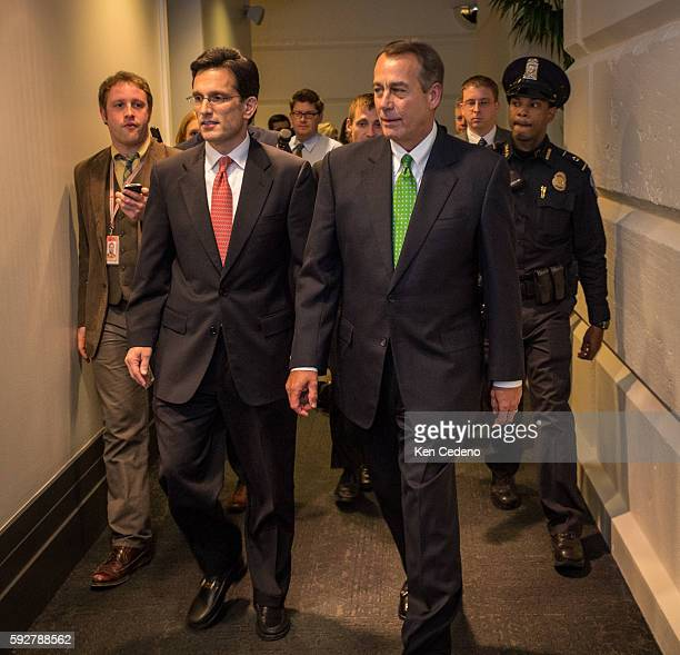 House Speaker John Boehner right and House Majority Leader from Eric Cantor left walk into a Republican caucus meeting to consider the terms of the...