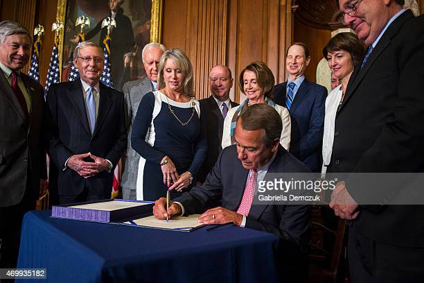 House Speaker John Boehner signs the Medicare Access CHIP Reauthorization Act 2015 HR 2 during a press event at the Capitol on April 16 2015 in...