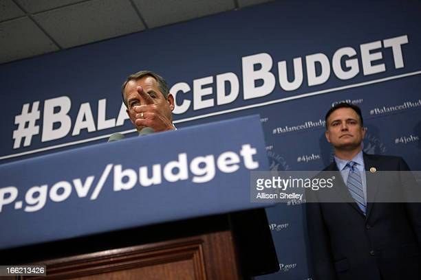 House Speaker John Boehner speaks to the media about balancing the budget as Rep Luke Messer watches on Capitol Hill April 10 2013 in Washington DC...