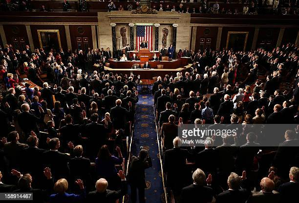 House Speaker John Boehner swears in the newly elected members of the first session of the 113th Congress in the House Chambers January 3 2013 in...