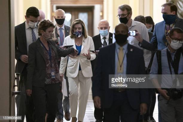 House Speaker Nancy Pelosi, a Democrat from California, center, speaks to members of the media as she walks to her office at the U.S. Capitol in...