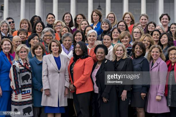 US House Speaker Nancy Pelosi a Democrat from California fourth left stands for a photograph with House Democratic women members of the 116th...