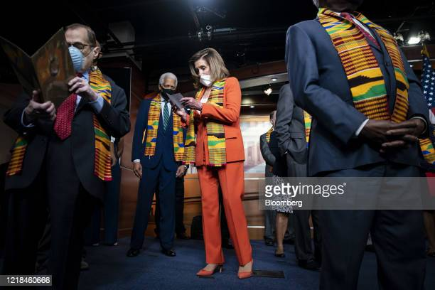 US House Speaker Nancy Pelosi a Democrat from California looks at her notes during a news conference unveiling policing reform and and equal justice...
