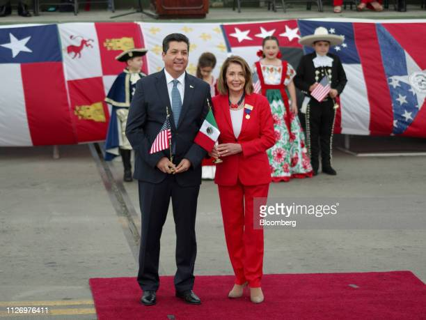 House Speaker Nancy Pelosi, a Democrat from California, right, exchanges flags with Francisco Garcia Cabeza de Vac, governor of Tamaulipas state, on...