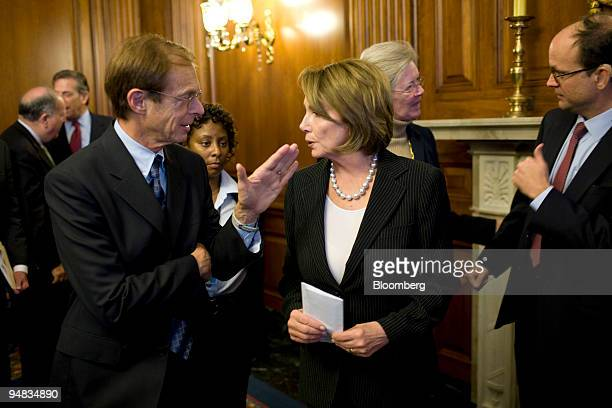 House Speaker Nancy Pelosi a Democrat from California right speaks with Allen Sinai chief economist at Decision Economics Inc left following a news...