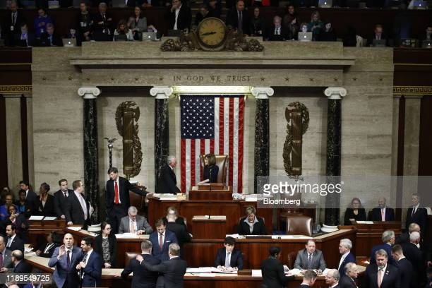 House Speaker Nancy Pelosi, a Democrat from California, stands on teh dais as House members vote on the second article of impeachment against...