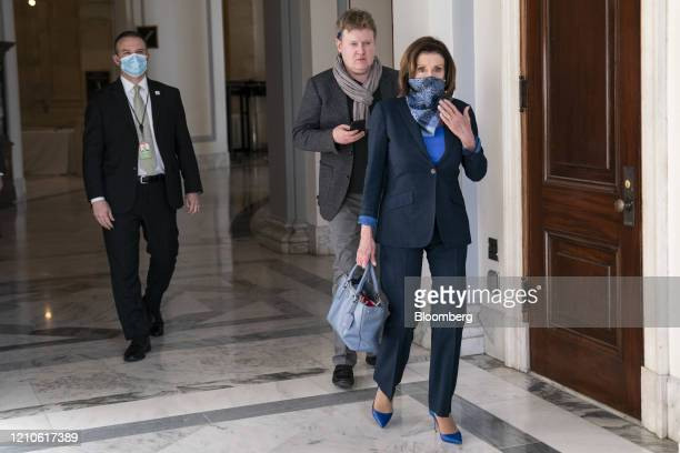 House Speaker Nancy Pelosi, a Democrat from California, wears a protective mask in the Russel Senate Office Building on Capitol Hill in Washington...