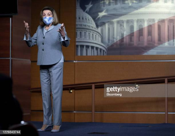 US House Speaker Nancy Pelosi a Democrat from California wears a protective mask while speaking during a news conference at the US Capitol in...