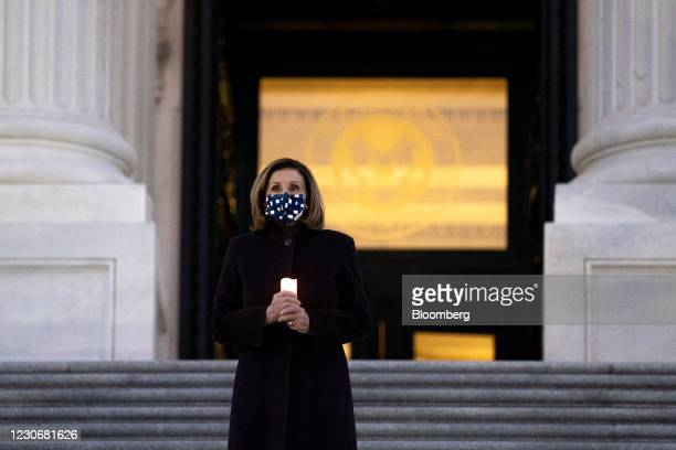 House Speaker Nancy Pelosi, a Democrat from California, wears a protective mask while participating in a Covid memorial outside the U.S. Capitol in...