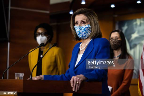 House Speaker Nancy Pelosi, a Democrat from California, wears a protective mask while speaking during a news conference at the U.S. Capitol in...