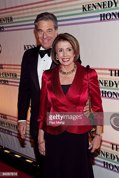 House Speaker Nancy Pelosi and Paul Pelosi arrive to the 32nd Kennedy Center Honors at Kennedy Center Hall of States on December 6 2009 in Washington...