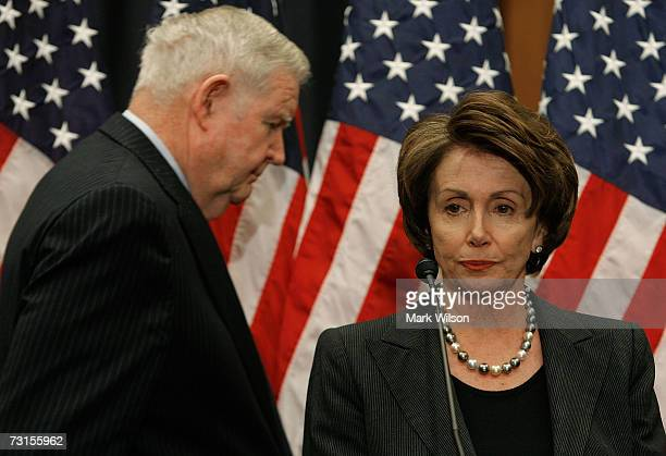 House Speaker Nancy Pelosi and Rep. John Murtha walk up to the podium at the start of a news conference on Capitol Hill January 30, 2007 in...