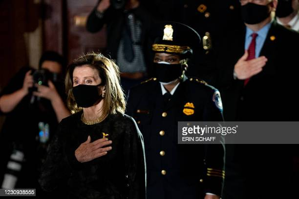 House Speaker Nancy Pelosi attends a ceremony to pay respects to the late Capitol Police Officer Brian Sicknick who lies in honor in the Rotunda of...
