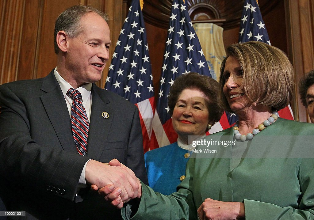 House Speaker Nancy Pelosi (D-CA) (R) congratulates Rep. Mark Critz (D-PA) (L) while Joyce Murtha (C) looks on moments after he was sworn in on the floor of the House on Capitol Hill May 20, 2010 in Washington, DC. Rep. Critz is filling the 12th district seat of Pennsylvania that was once held by the late Rep. John Murtha.