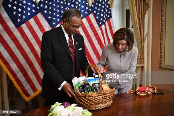 House Speaker Nancy Pelosi DCA and Rep Emanuel Cleaver DMO hold an event to settle a wager over Super Bowl LIV between the San Francisco 49ers and...
