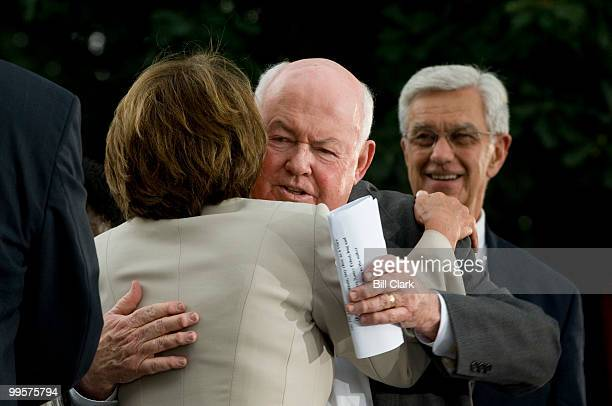 House Speaker Nancy Pelosi DCalif hugs AFLCIO President John Sweeney as she arrives for the AFLCIO Rally celebrating the minimum wage increase in...