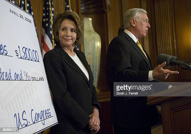 House Speaker Nancy Pelosi DCalif stands next to a tax rebate check mockup as House Majority Leader Steny Hoyer DMd speaks during a news conference...