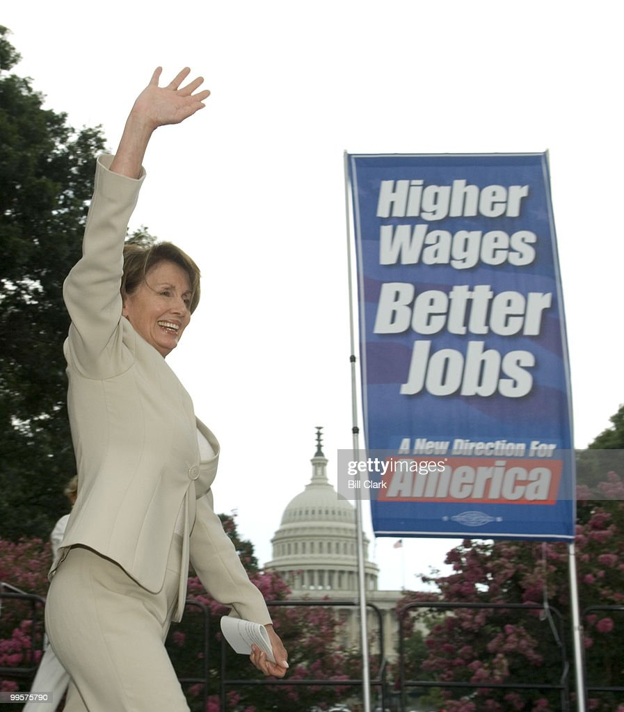 House Speaker Nancy Pelosi, D-Calif., waves to labor union members as she arrives for the AFL-CIO Rally celebrating the minimum wage increase in Upper Senate Park on Tuesday, July 24, 2007.