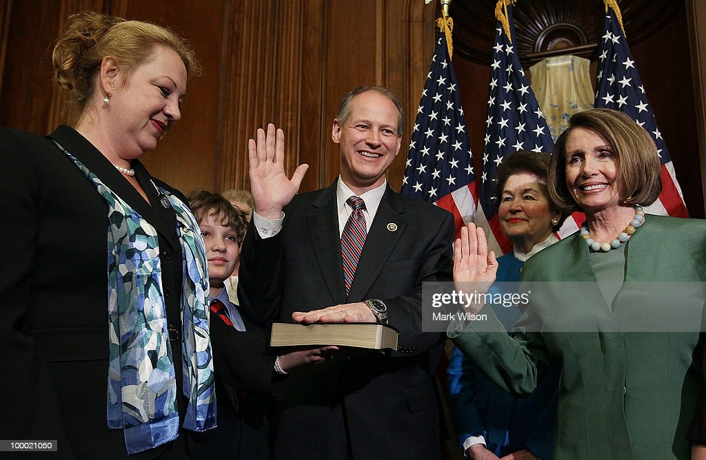 House Speaker Nancy Pelosi (D-CA) (R) is flanked by Joyce Murtha (2nd-R) and Nancy Critz (L) during a mock swearing-in for Rep. Mark Critz (D-PA) (C) moments after he was sworn in on the floor of the House on Capitol Hill, May 20, 2010 in Washington, DC. Rep. Critz is filling the 12th district seat of Pennsylvania that was once held by the late Rep. John Murtha.