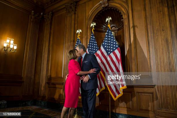 House Speaker Nancy Pelosi kisses her husband Paul Pelosi on Capitol Hill on January 3 2019 in Washington DC Under the cloud of a partial federal...
