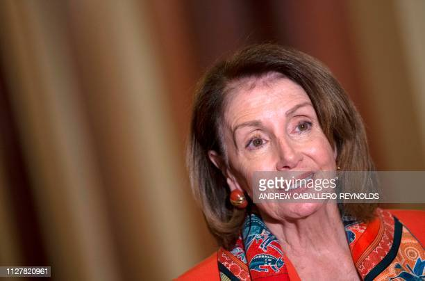US House Speaker Nancy Pelosi looks on near security as European Parliament President Antonio Tajani speaks during a press conference at the US...