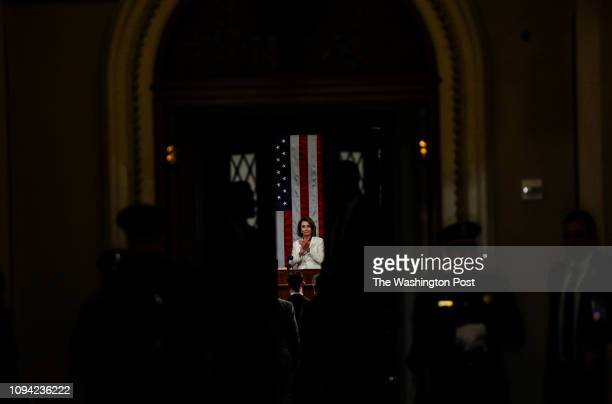 House Speaker Nancy Pelosi seen through the doors to the chamber before the State of the Union address before members of Congress in the House...
