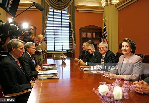 House Speaker Nancy Pelosi sits with White House Chief of Staff Josh Bolten Senate Majority Leader Harry Reid Senate Minority Leader Mitch McConnell...